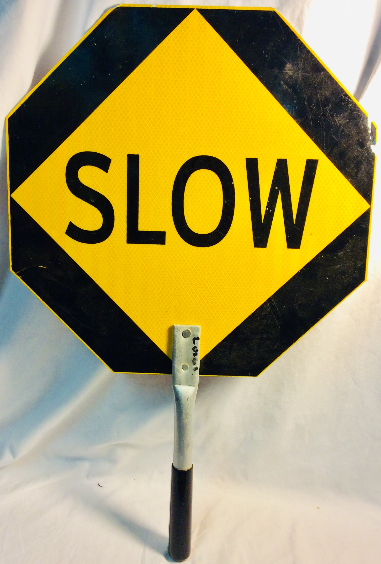 Double sided STOP/SLOW road sign