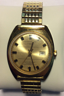 Timex watch - Round gold face, gold