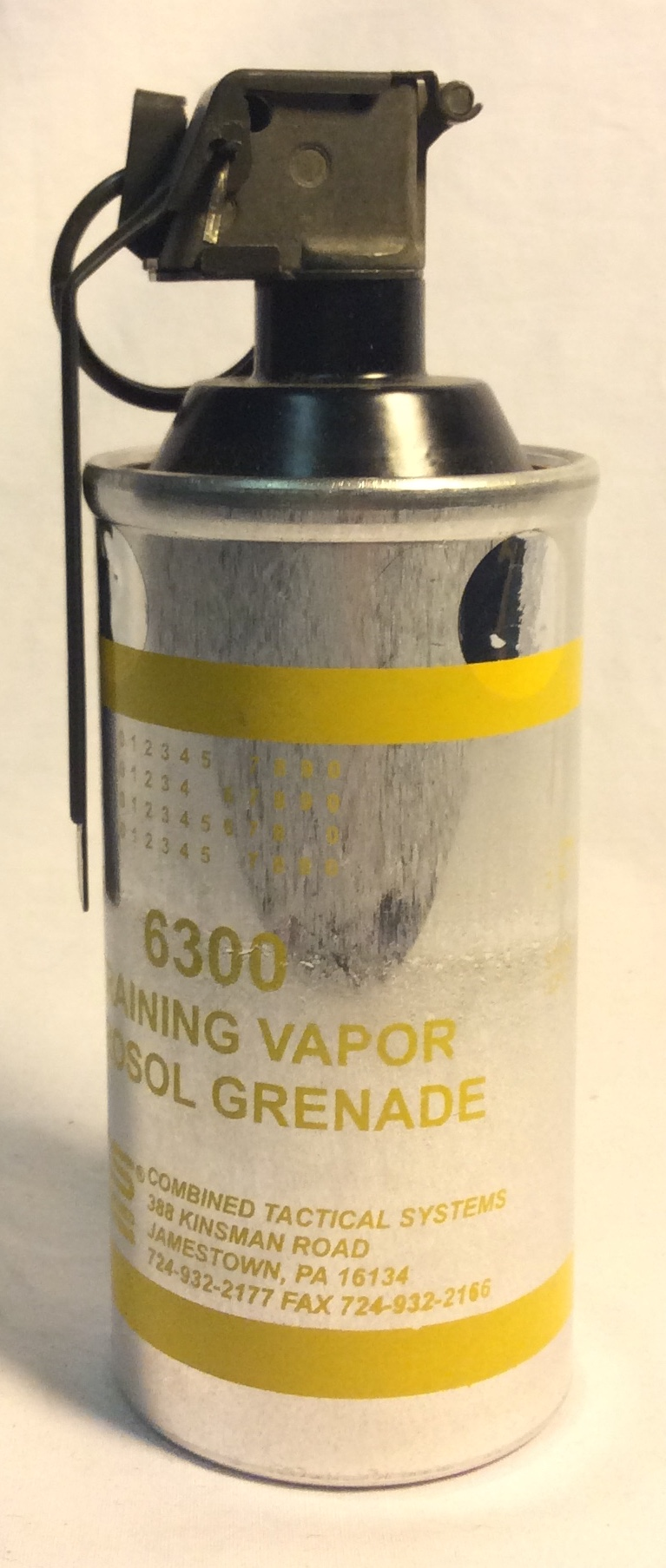 "Combined Tactical systems aerosol grenade ""tear gas"" silver with yellow writing"