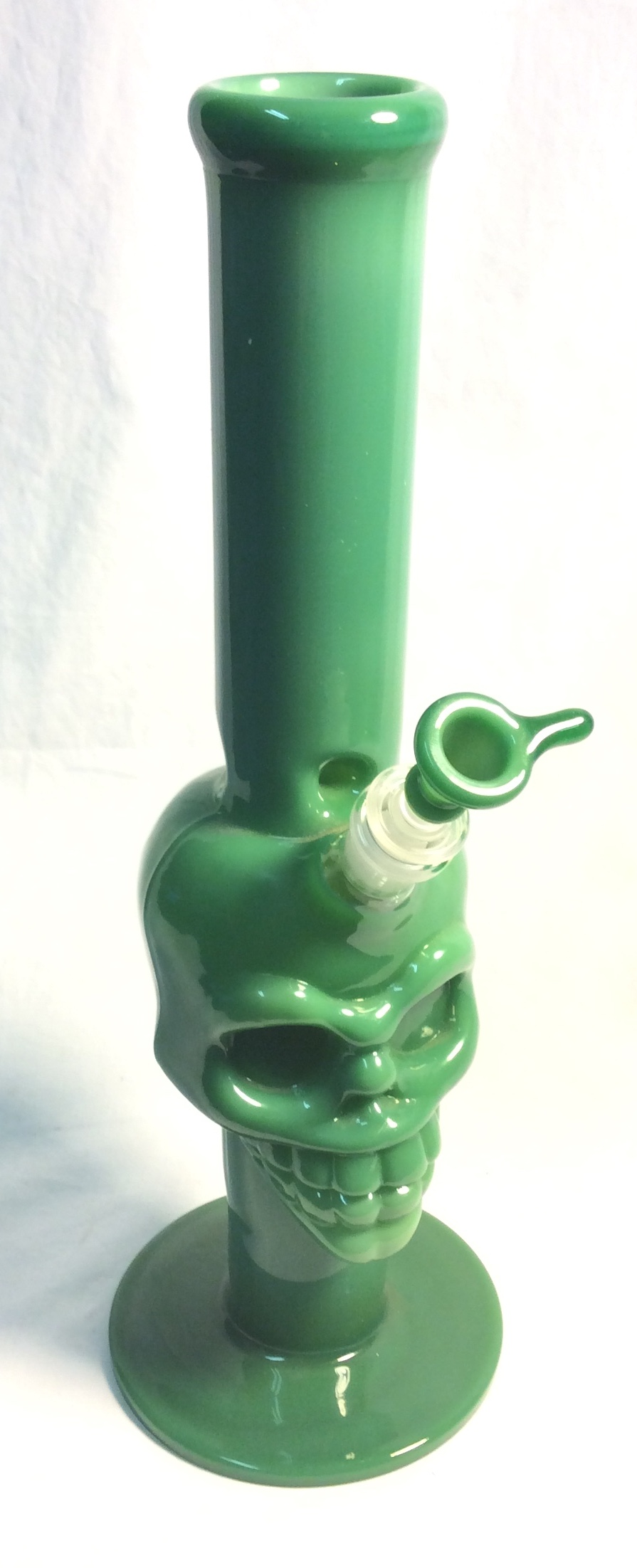 "Green glass skull bong, 15"" tall"