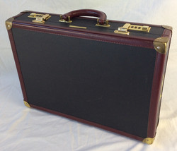 Snazzy black suitcase with burgundy leather and gold details