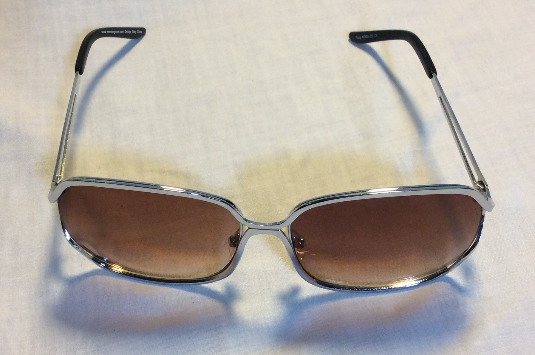 Large square silver sunglasses