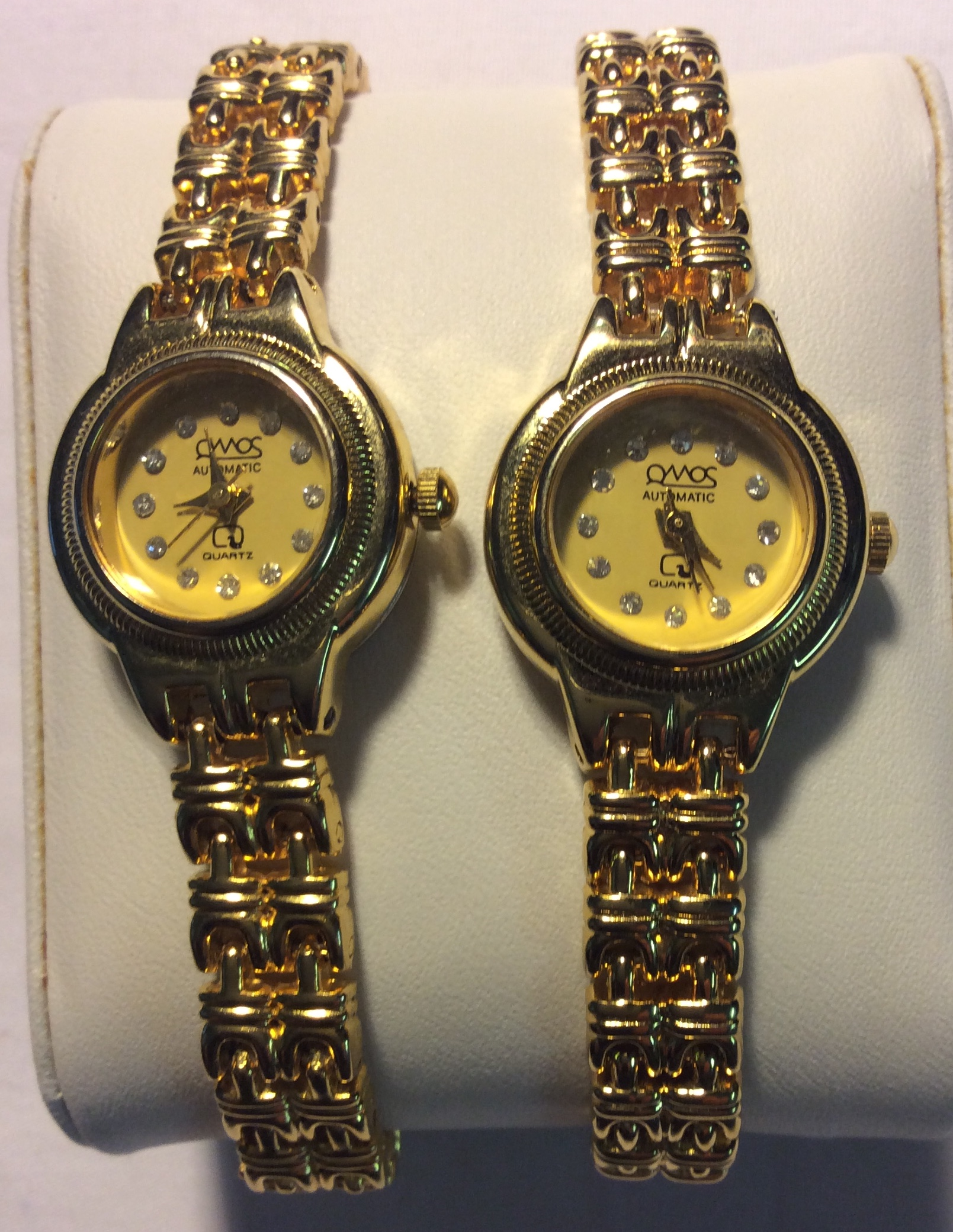 Qiomos watch - round gold face