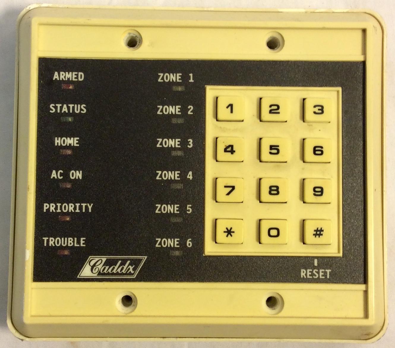 Caddx Home alarm keypad. Plastic.