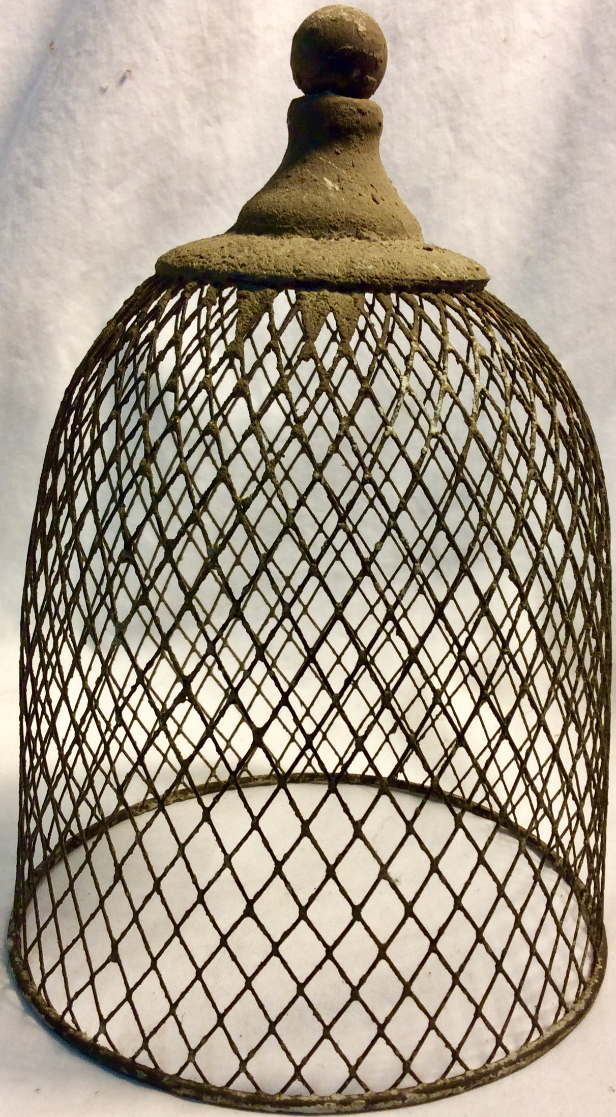 Portable bird cage, metal and concrete like material.