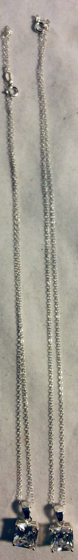 Necklace with very thin faux diamond pendant