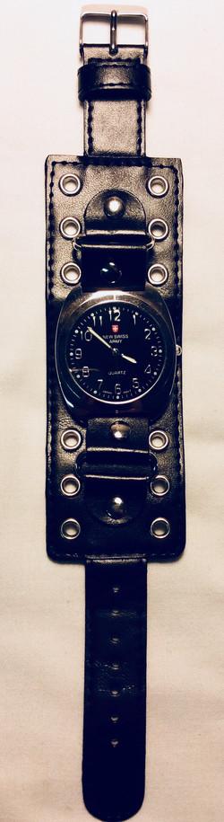 Black rivet strap watch