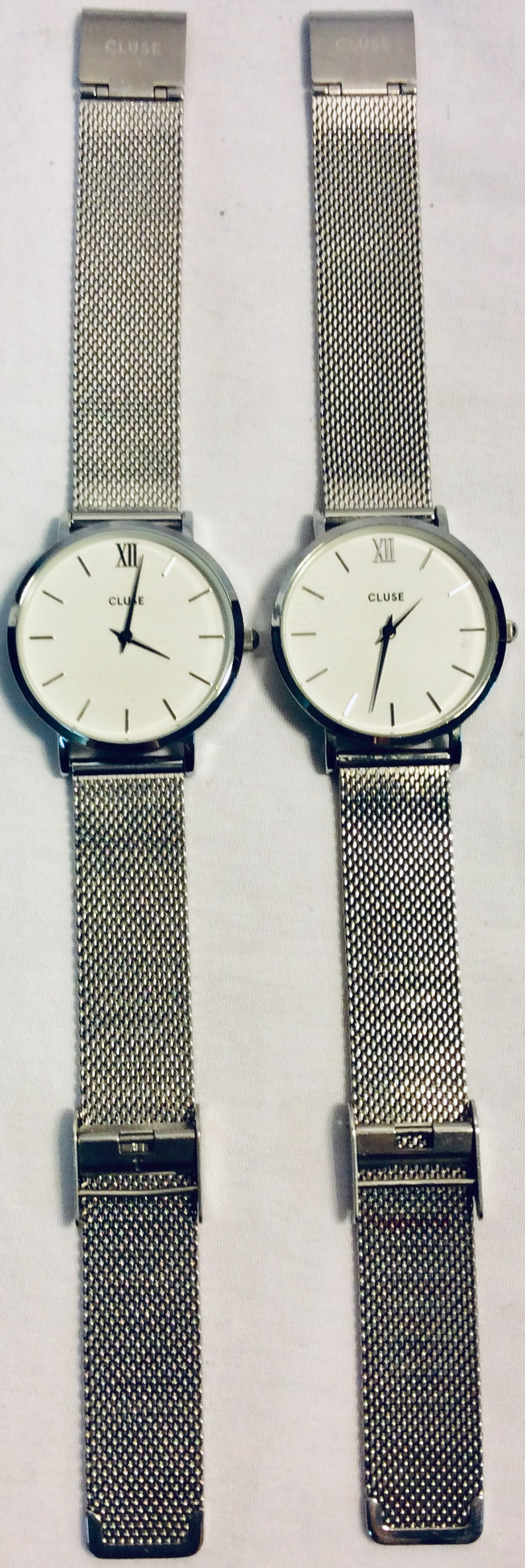 Cluse White face with silver details and woven metal band