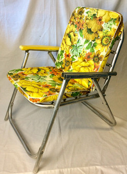 Retro metal lawn chair with removable floral cushion.