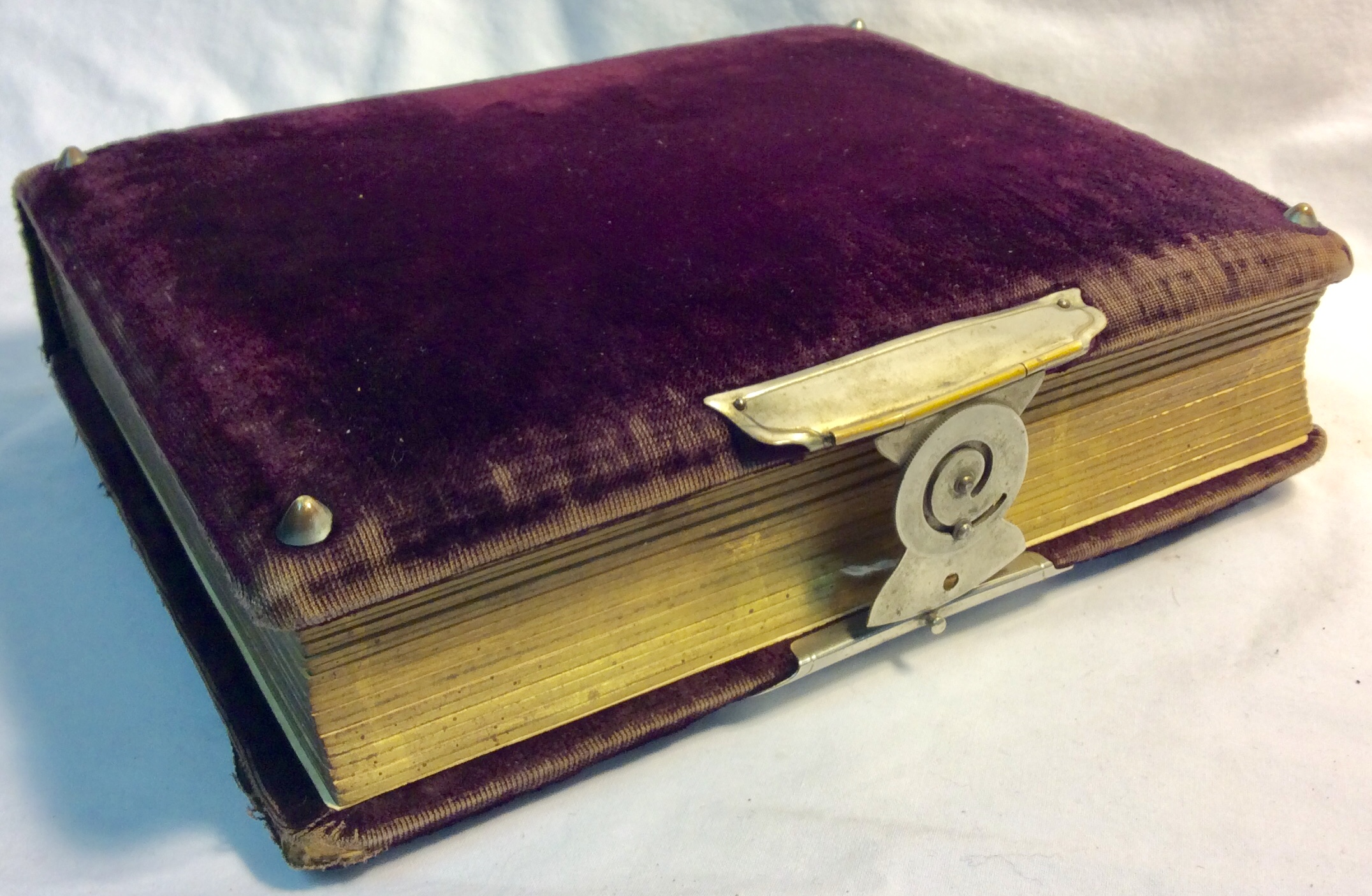 Antique photo album with purple aged velvet cover