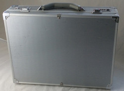 Large silver hard shell briefcase with number lock