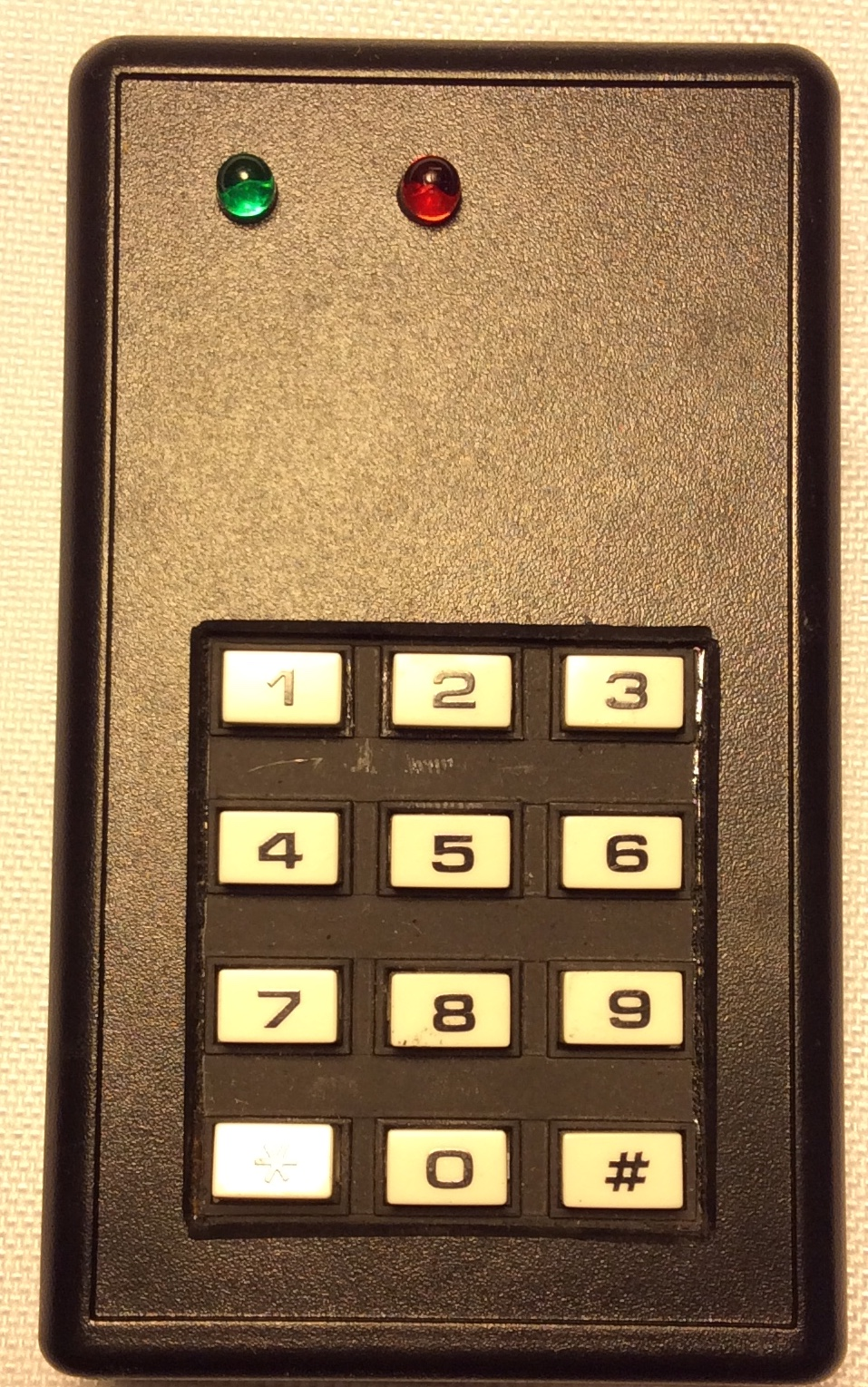 Black plastic keypad with white keys