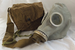 Full gas mask with entire head coverage. In a small brown-green bag. Vintage/military 1940s