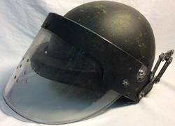 Aged metal ballistic/anti riot helmet with visor.
