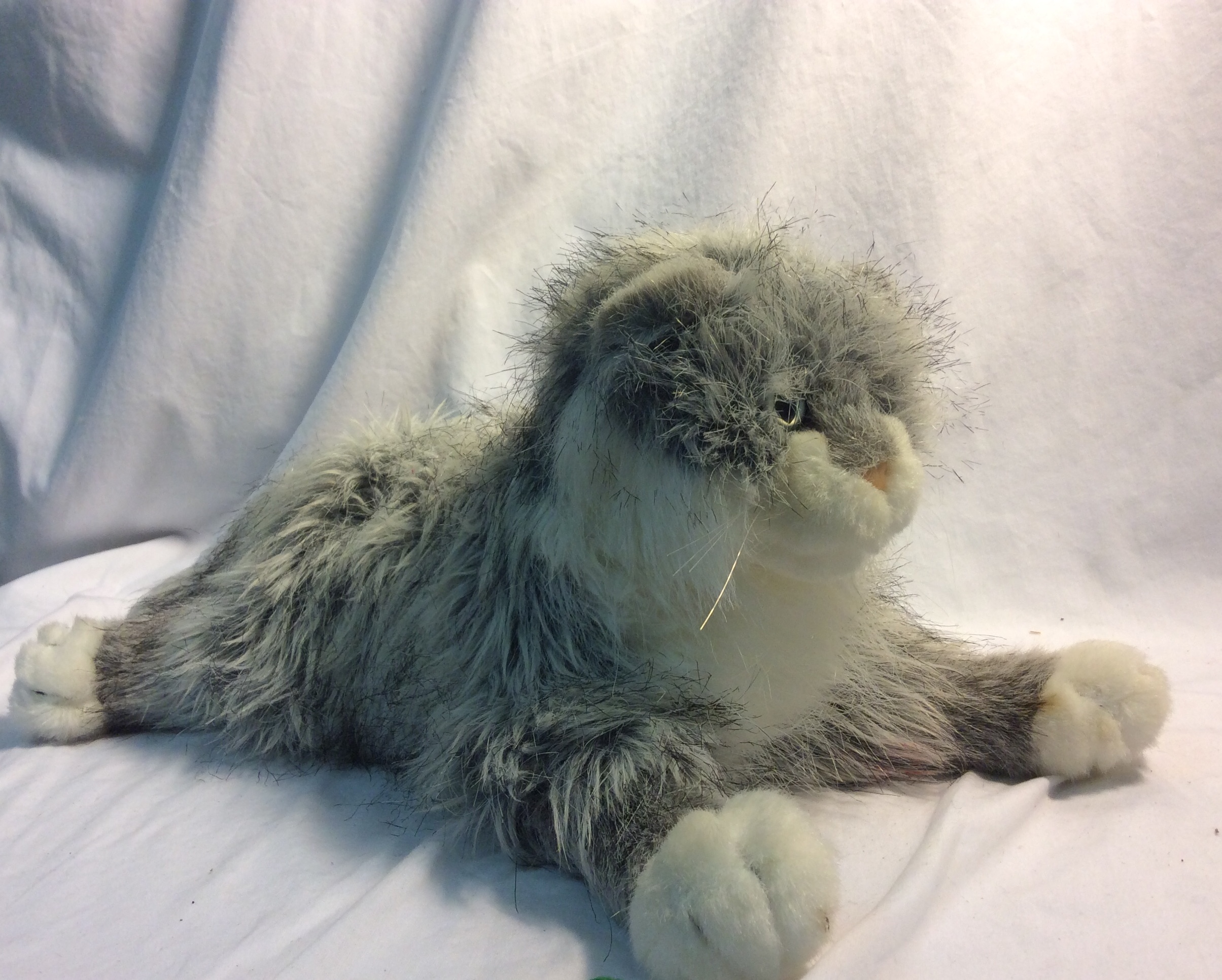 Grey and white soft stuffed cat
