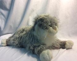 Grey and white soft stuffed cat