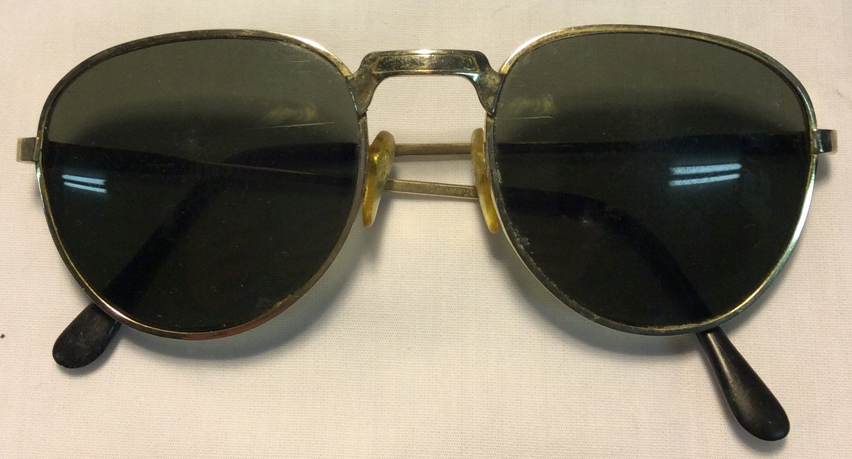 Gold metal frames, black plastic