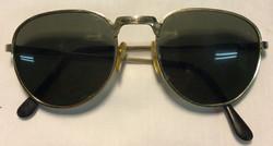 Gold metal frames, black plastic