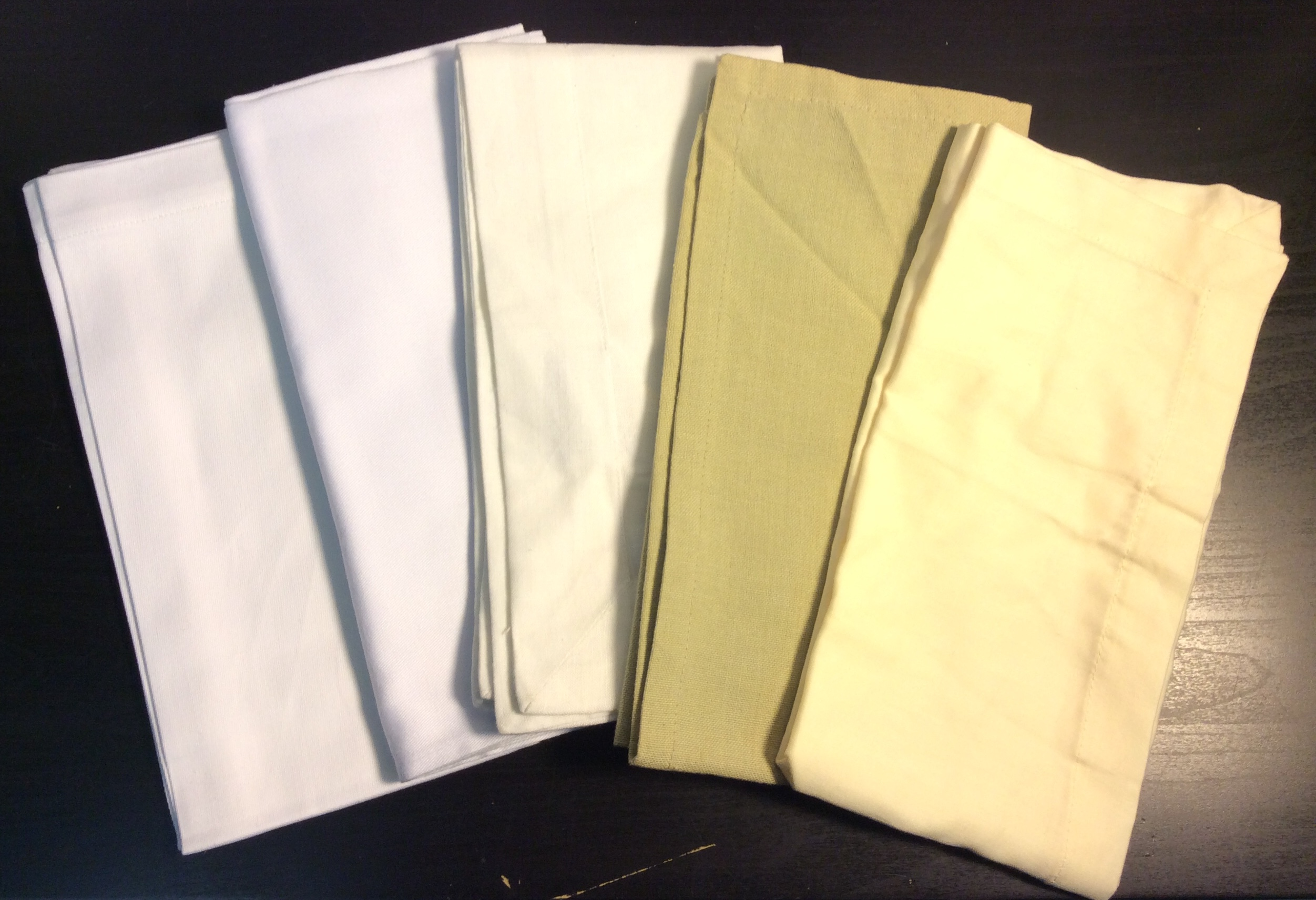 "Cloth Napkins 20""x20"" - x10 offwhite, x4 white, x3 wide hem, x4 green, x11 yellow"