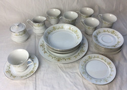 Vintage tea set with cups, saucers, bowls, side plates, one large plate.
