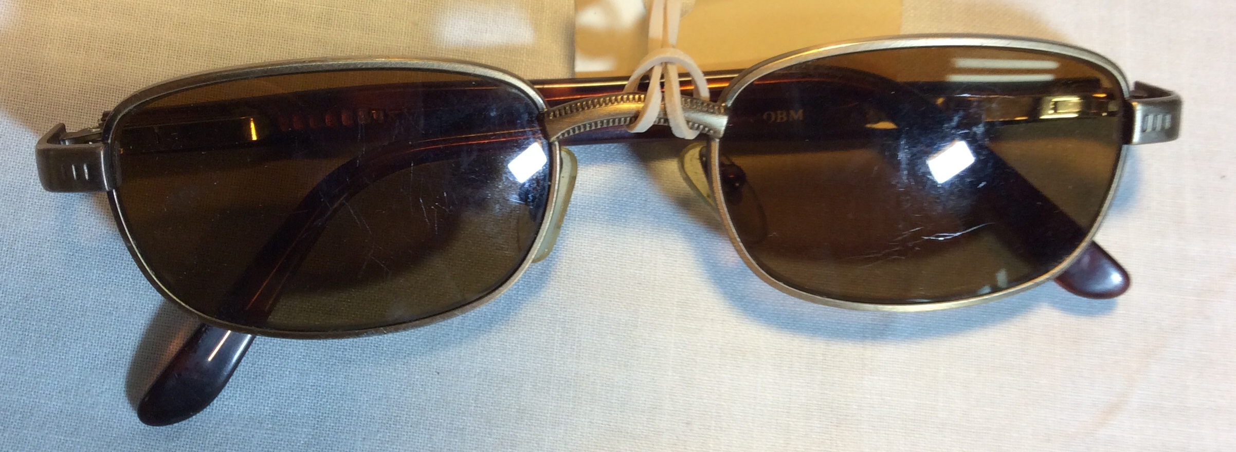 Gold metal framed period sunglasses