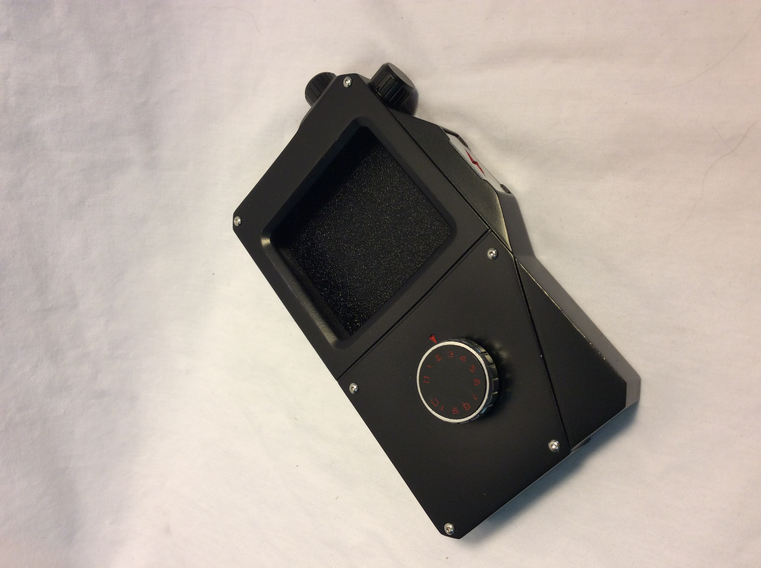 Handheld Remote case holds smartphone inside
