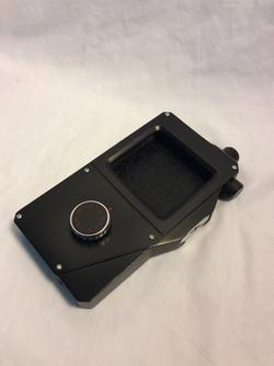 Handheld Remote case holds smartphone inside