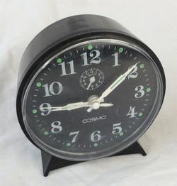 Cosmo Retro analogue clock, black plastic.