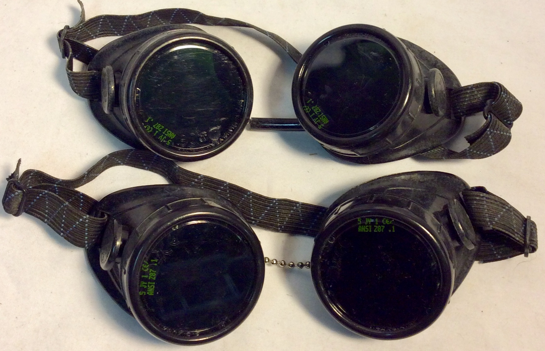 Welders safety goggles with dark green lenses