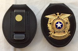 Gold Federal Air Marshal US badge with leather carrier