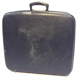 Aged hard black suitcase
