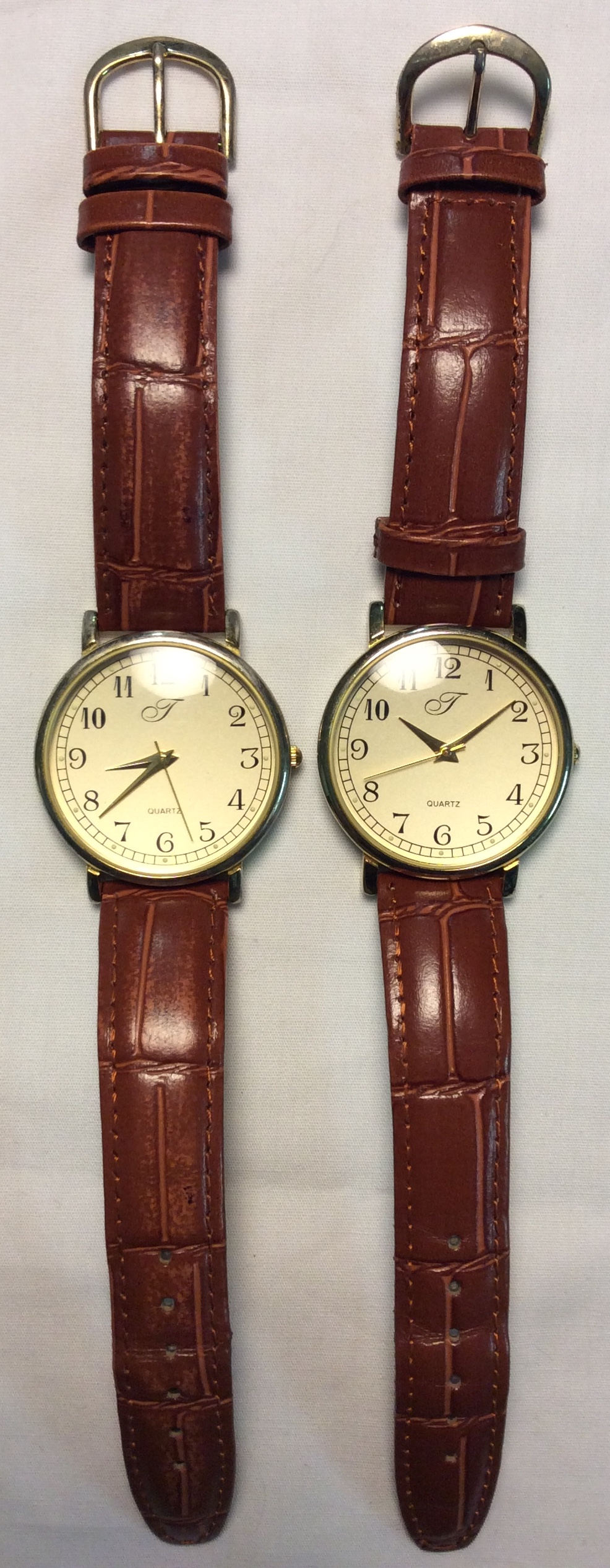 J watch - round gold face with gold