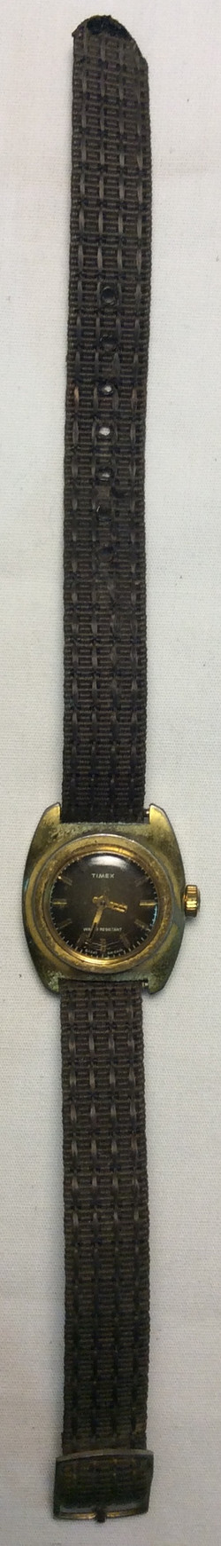 Timex watch - round aged gold face
