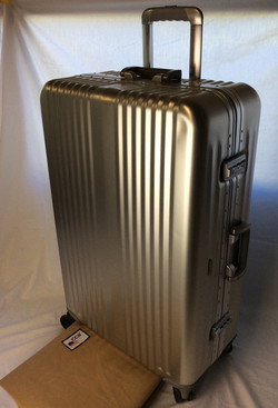 High-end silver hard-shell suitcase with protector bag.