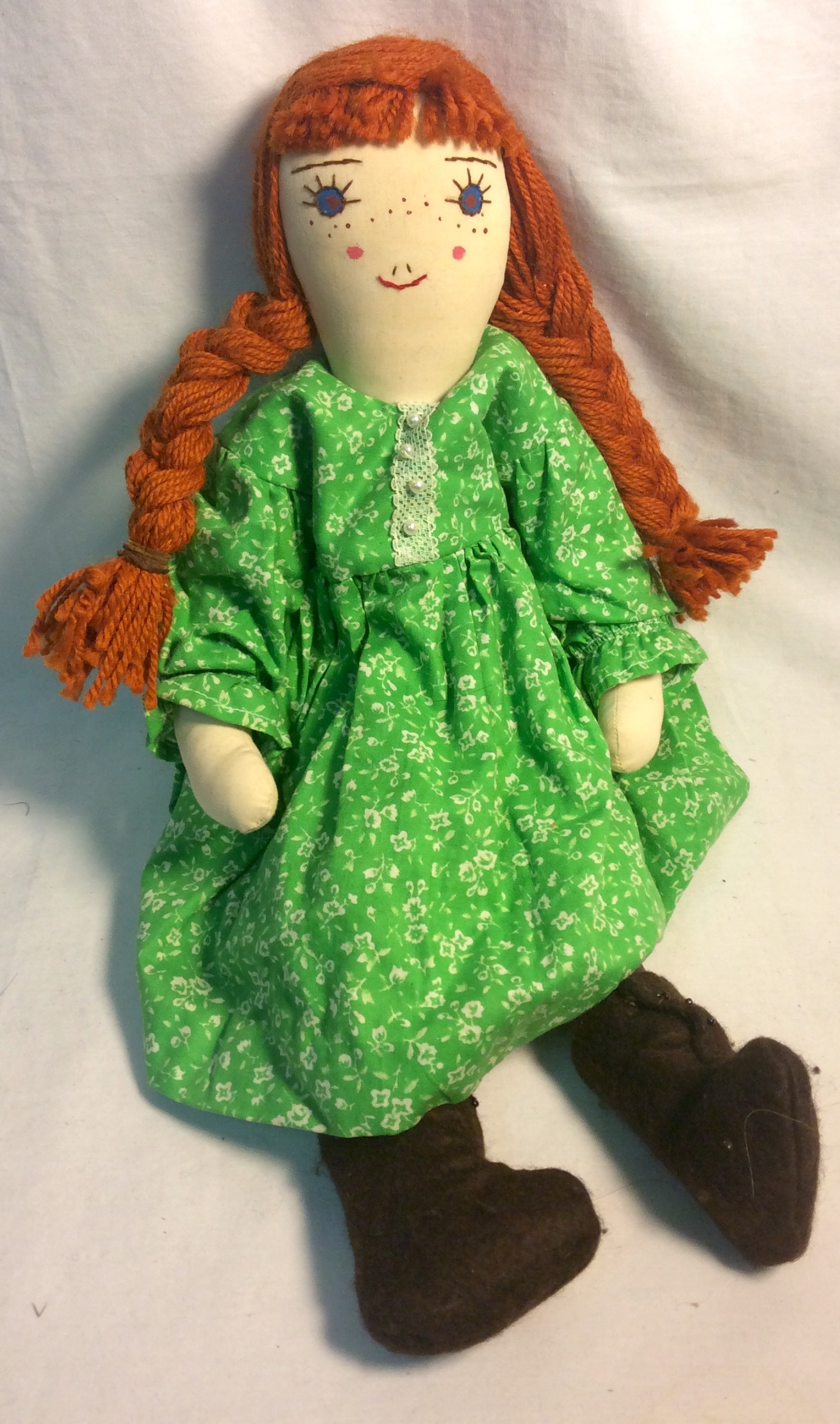 Village Craft House Vintage-style, stuffed cloth doll with green dress and orange yarn hair