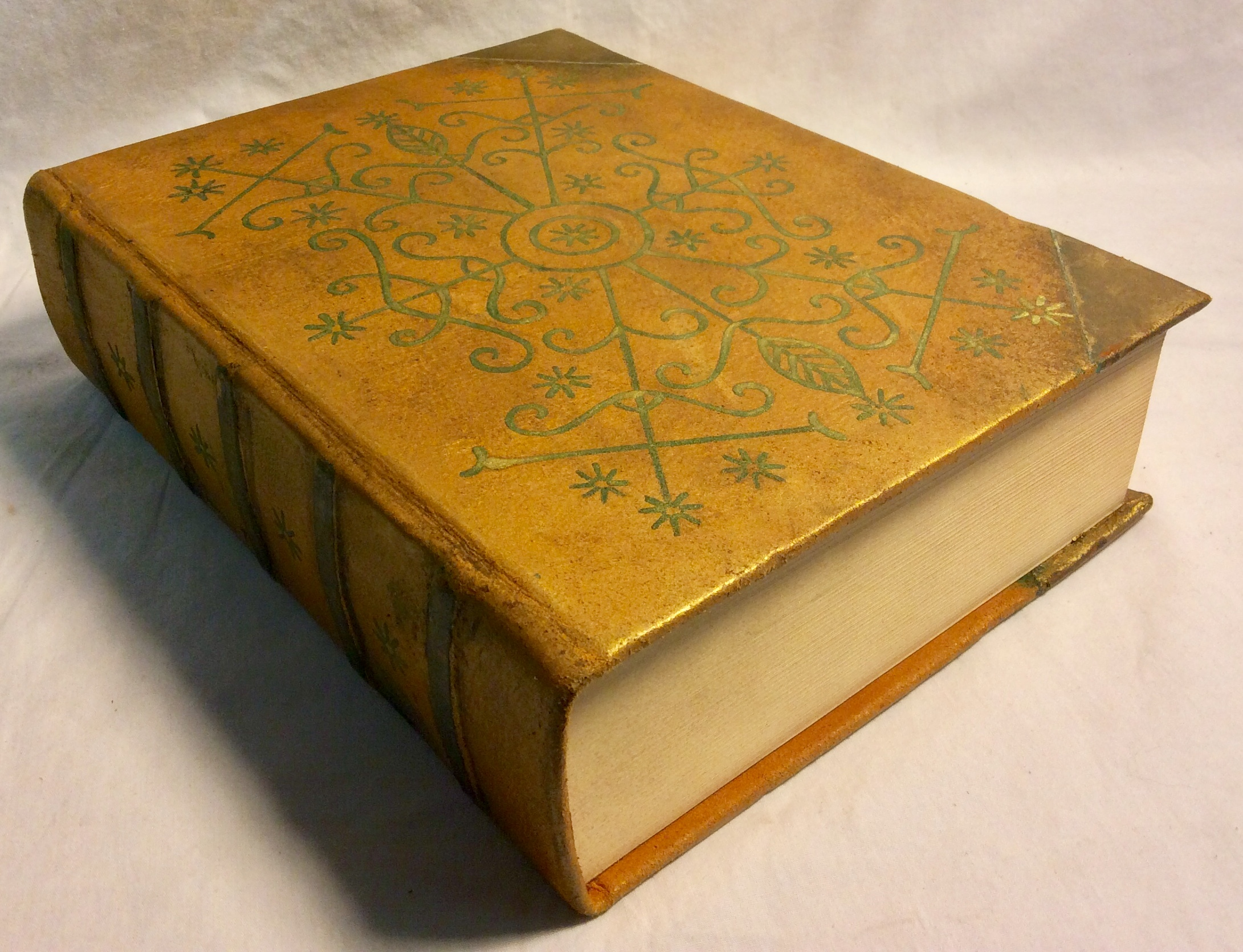 Gold detailed, hardcover magic book with built pages