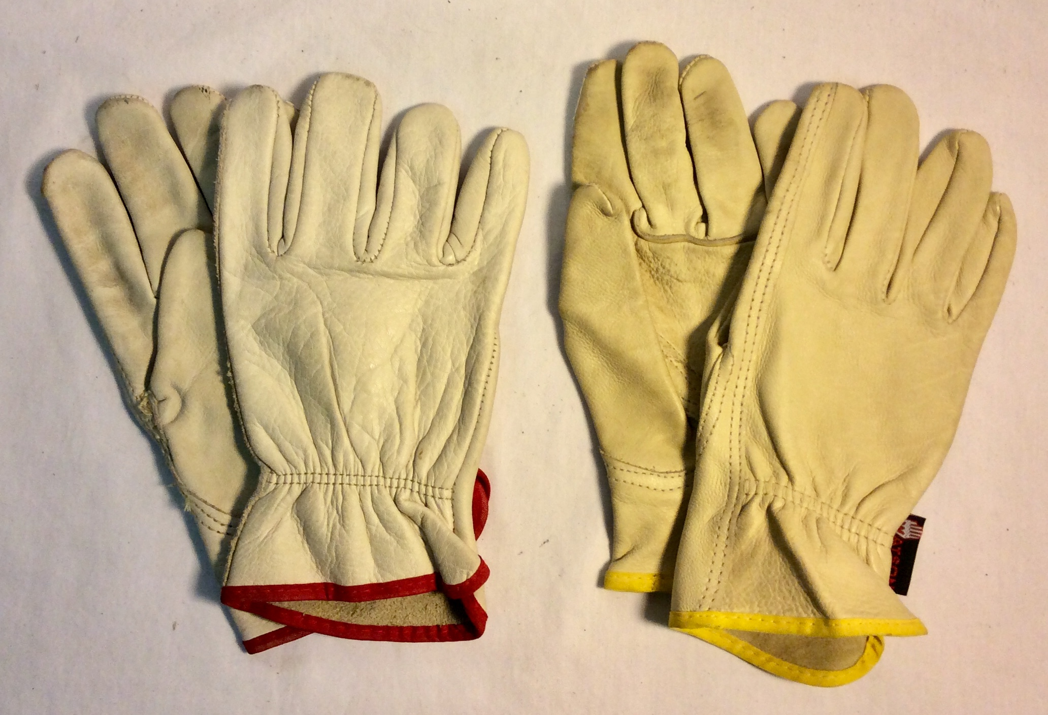 White soft leather gloves (WATSON) x1 pair with yellow lining; x1 pair with red lining