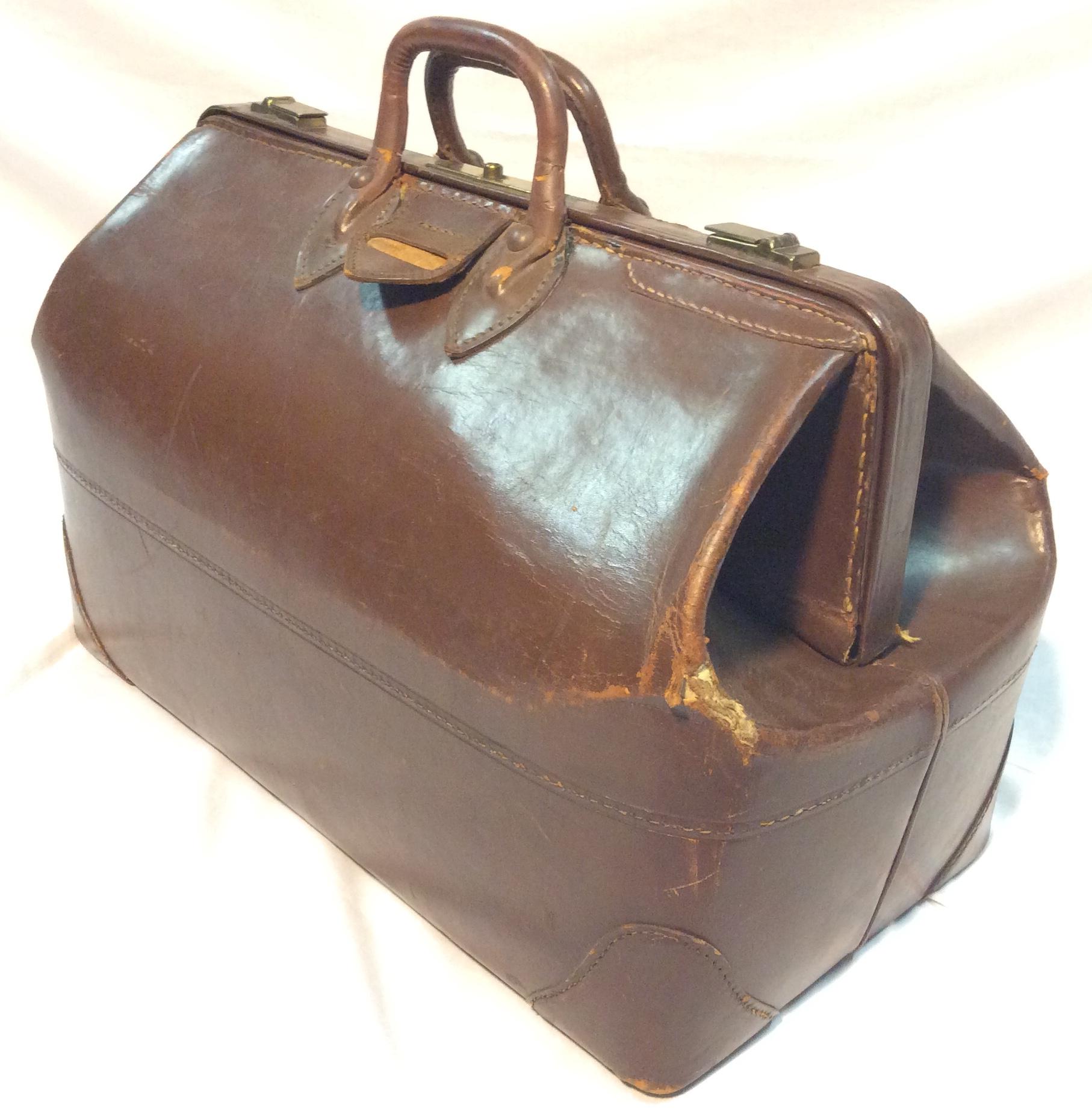 Vintage Dark brown leather suitcase