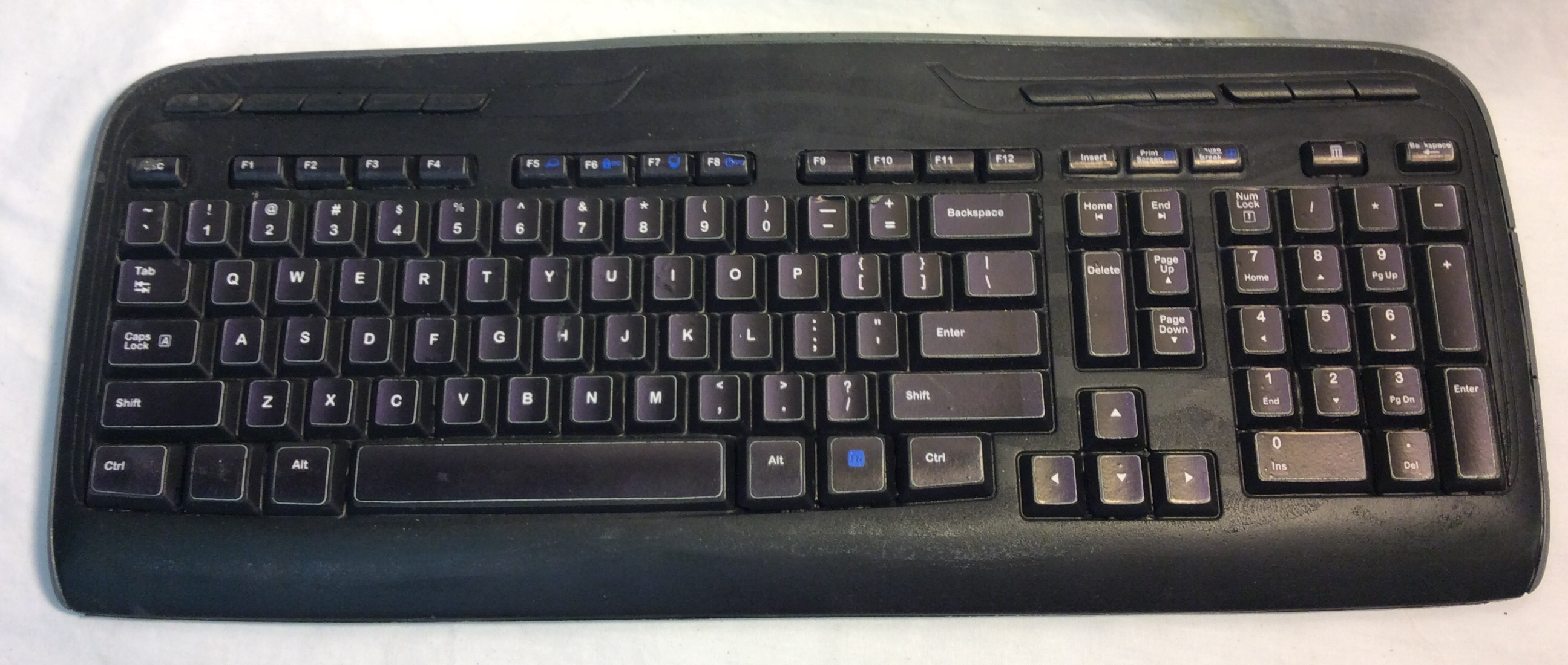 Black computer keyboard - 5 real and 2 rubber