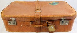 Brown aged leather suitcase with single strap and buckles