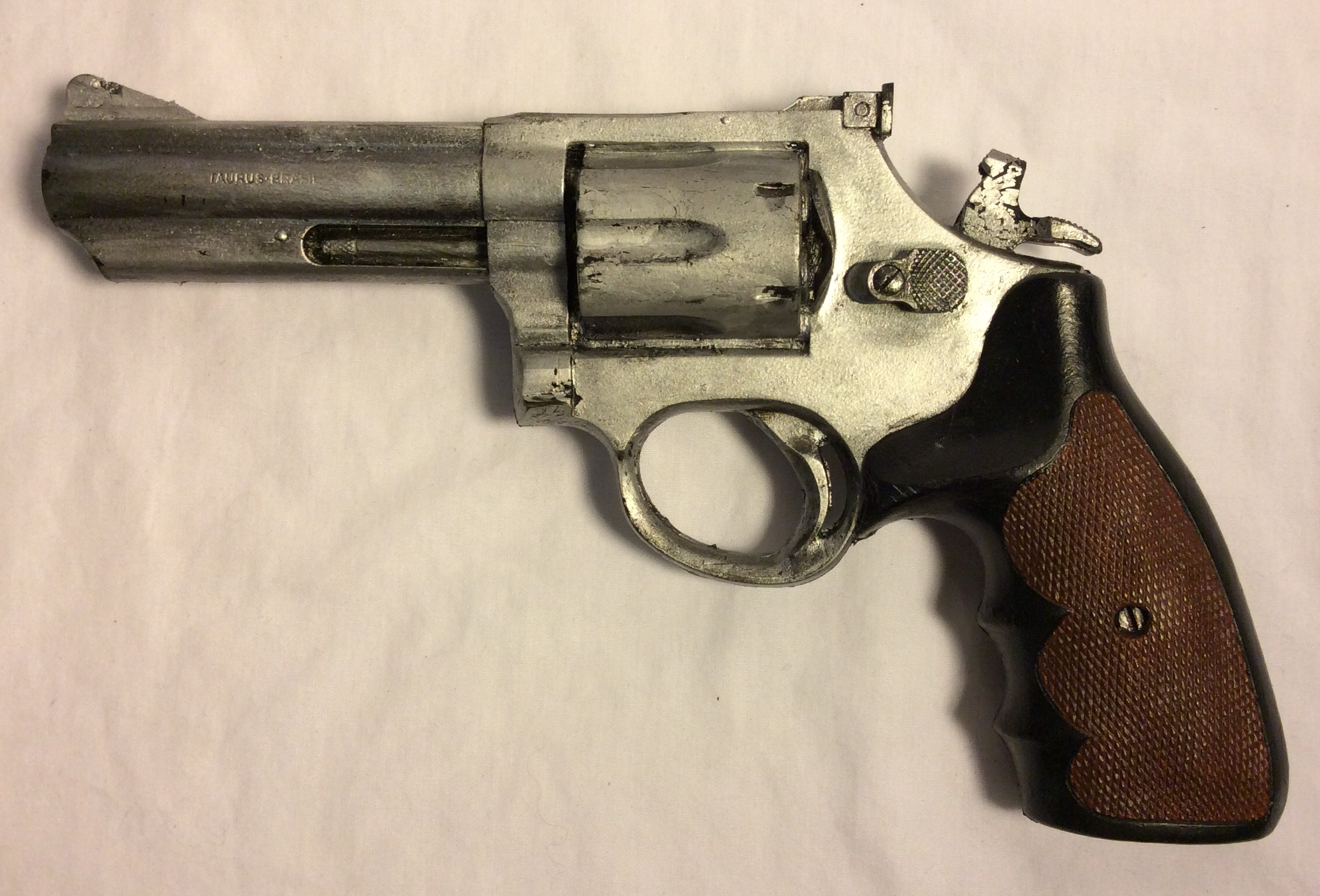Taurus 357 Magnum, silver with brown/black handle soft rubber handgun