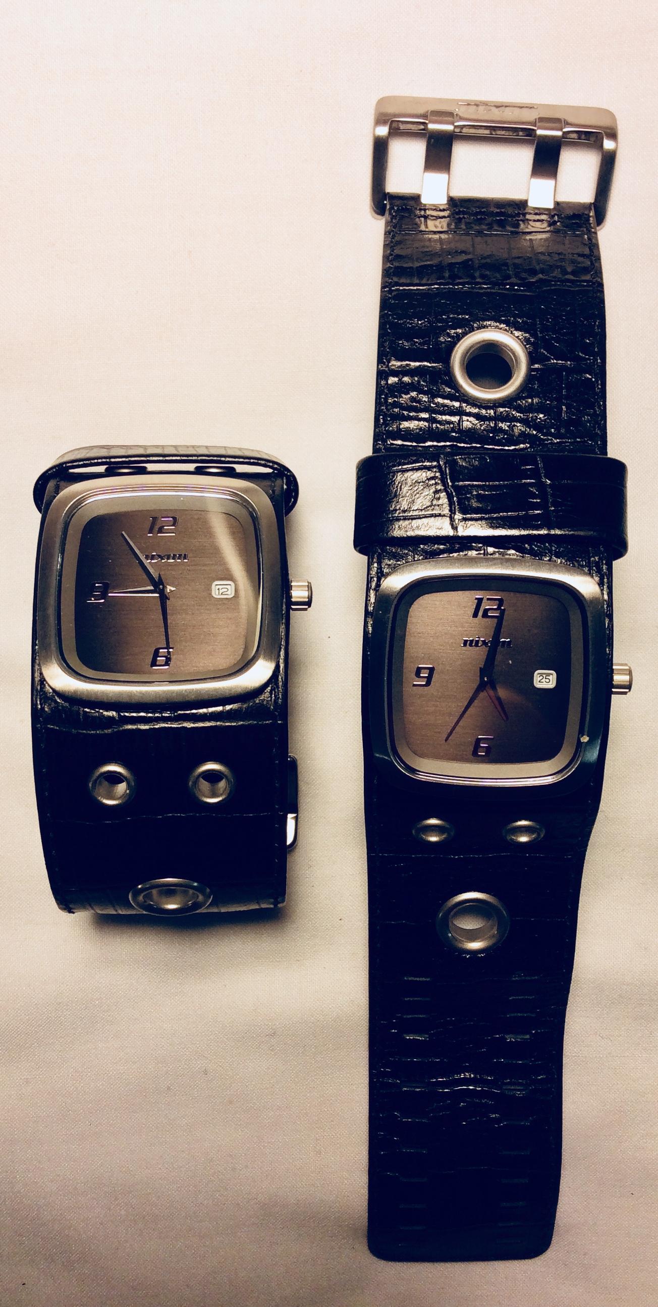 Grey steel face watch