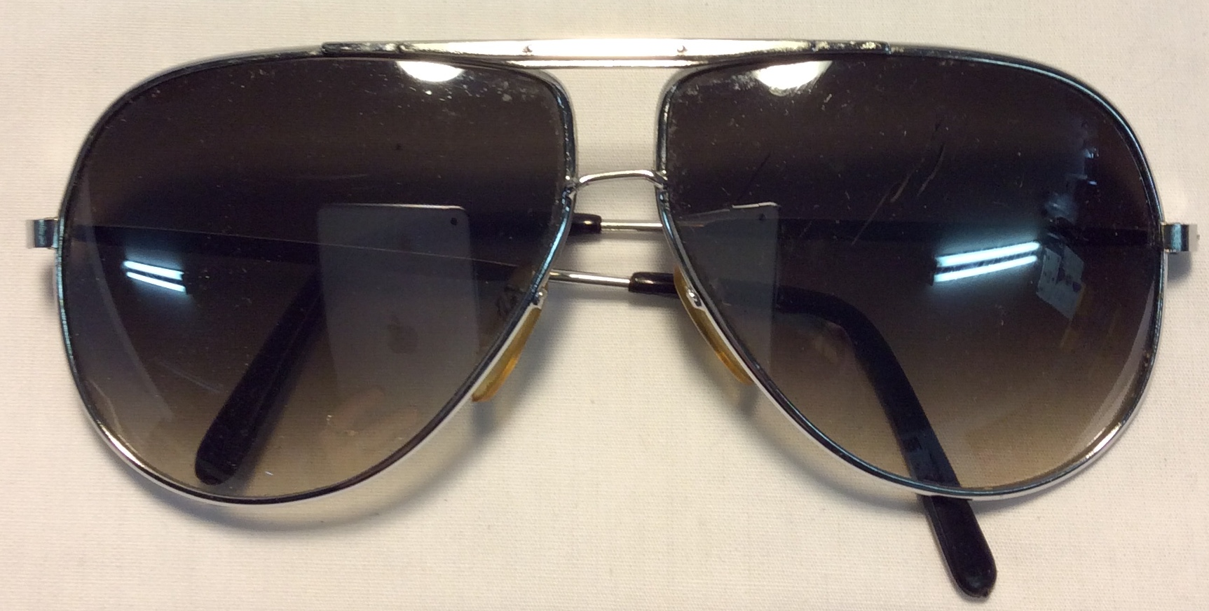 Silver plastic frames, black plastic