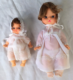 Pair of baby dolls. One child, one toddler.