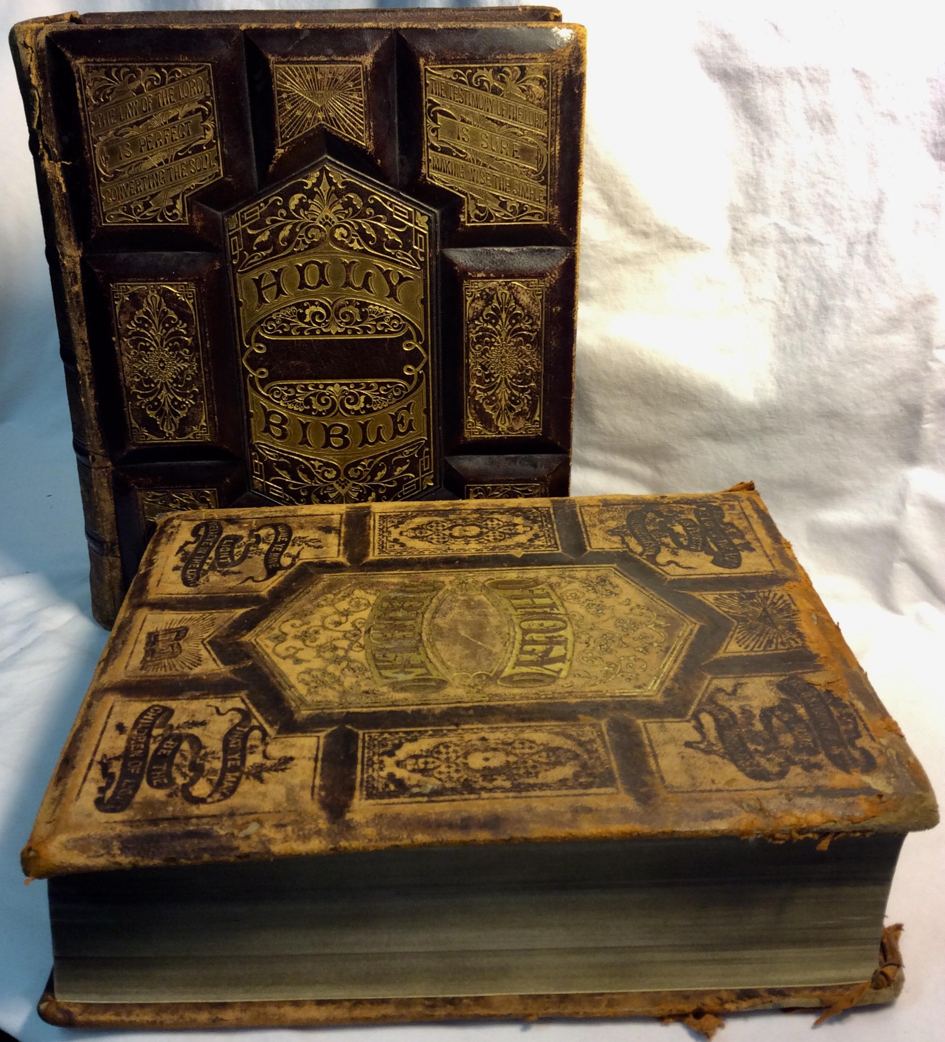 Antique large bibles. One with blank pages.
