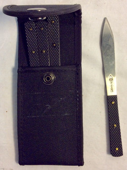 Black nylon pouch with 4 small throw knives