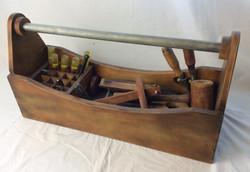 Vintage large wooden toolbox with vintage tools.