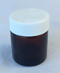 Tiny brown glass medical canister