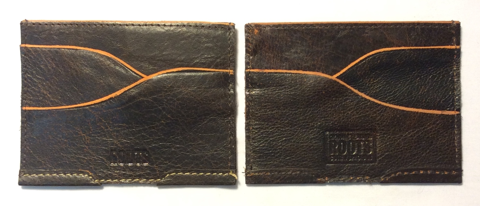 Roots Dark brown curved leather