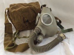 Full gas mask bag with mouth tube. In a small brown-green bag. Vintage/military 1940s